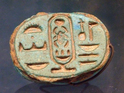 Golden ring, with cartouche and hieroglyphic name of Tutankhamun: 'Perfect God, Lord of the Two Lands' ('Ntr-Nfr, Neb-taui'; right to left columns)—Musée du Louvre.