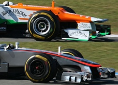"The reduction in the height of the nose led to several teams using a ""platypus"" nose design, as seen in the Force India VJM05 (top). However, McLaren did not use this design, as evidenced in the McLaren MP4-27 (bottom)."