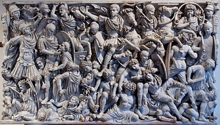 "On the Ludovisi sarcophagus, an example of the battle scenes favoured during the Crisis of the Third Century, the ""writhing and highly emotive"" Romans and Goths fill the surface in a packed, anti-classical composition[490]"