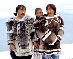Traditional clothing; left: seal, right: caribou.