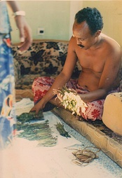Man in Mogadishu dividing khat into bunches for guests in preparation for a long evening of tea, conversation and chewing