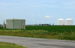 Peoples Gas Manlove Field natural gas storage area in Newcomb Township, Champaign County, Illinois. In the foreground (left) is one of the numerous wells for the underground storage area, with an LNG plant, and above ground storage tanks are in the background (right).