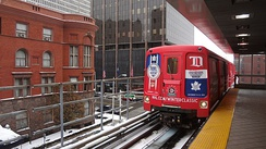 The People Mover enters Michigan Avenue station.