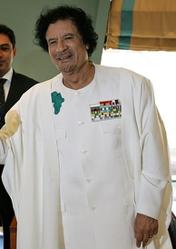 Gaddafi wearing an insignia showing the image of the African continent