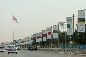 Flags of countries in attendance along with the motto put up for the summit in Tehran