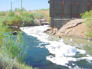 Raw sewage and industrial waste in the New River as it passes from Mexicali to Calexico, California