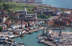A view of Old Portsmouth taken from the viewing deck of the Spinnaker Tower. Old buildings, cobbled streets and a small island can be seen in the frame.