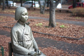 The bronze statue of a comfort woman in front of the Japanese Embassy, Seoul