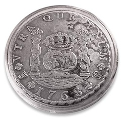A Spanish colonial silver coin, minted in Potosí in 1768, featuring the columns and the hemispheres