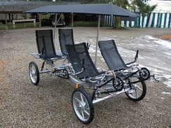 A modern touring 4-wheel bike - a 2011 model Quattrocycle four seater with canopy[33]