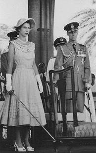Queen Elizabeth II holding a sword, prepared to knight subjects in Aden in 1954