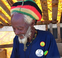 A Rastaman in Barbados, wearing a rastacap decorated in the Rastafari colours: green, gold, red and black