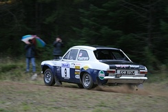 Pastrana driving a classic Ford Escort Mk1 at the 2008 Colin McRae Forest Stages.