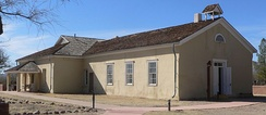 The one-room adobe schoolhouse in Tubac, Arizona, with a teacherage attached to the back.