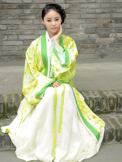 Woman wearing yellow and green hanfu, a traditional dress of the Han Chinese.
