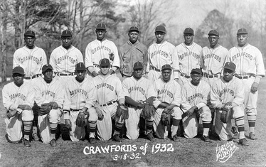 Paige (standing, 3rd from left) with the 1932 Pittsburgh Crawfords