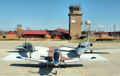 Aircraft of the 71st Operations Group. From left: A T-38 Talon, T-6A Texan II, and a T-1 Jayhawk are posed in front of the base control tower on the Vance flightline.
