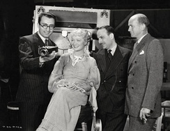 Rouben Mamoulian, Miriam Hopkins, visitor Michael Balcon, and Kenneth Macgowan on the set of Becky Sharp (1935)