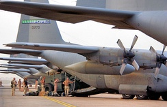 Members of the 778th Expeditionary Airlift Squadron, Pope Air Force Base, N.C., and members of the Global Mobility Assessment Team, 621st Air Mobility Group, McGuire AFB, N.J., load a forklift onto a C-130 Hercules in support of Operation Iraqi Freedom in 2006