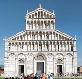 Pisa Cathedral, Italy. The entire building is faced with marble striped in white and grey. On the facade this pattern is overlaid with architectonic decoration of blind arcading below tiers of dwarf galleries. The three portals became increasingly common.