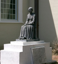 A statue of Evangeline—fictional heroine of the poem Evangeline by Longfellow—at St. Martinville, Louisiana. The statue was donated by actress Dolores del Río, who also posed for it. In a 1929 silent film by director Edwin Carewe, del Rio portrayed Evangeline.