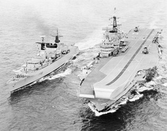 The flagship of the Carrier Group, HMS Hermes, alongside HMS Broadsword