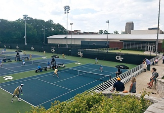 An outdoor match being played at the Ken Byers Tennis Complex