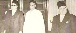 Left to right: Prime Minister Abdul Majid Kubar, Crown Prince Hasan and Taher Bakeer, Governor of Tripolitania.