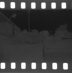 """Printed out"" image on a 35mm B&W film, overexposed by approximately 24 stops (about two days of exposure at f/2), without any chemical processing, showing that the silver clusters can grow up to visible sizes without developing."