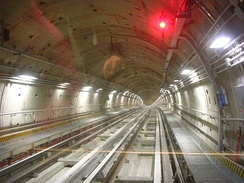 Inside a tunnel on the Turin Metro, the interlocking tunnel lining segments placed by a tunnel boring machine can be clearly seen.