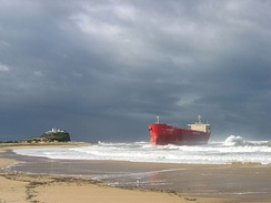 The MV Pasha Bulker briefly became a local landmark when it was stranded on Nobbys Beach in 2007