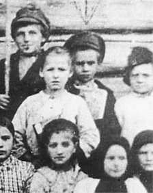 Pavlik Morozov (second row, in the middle): this is the only surviving photograph known of him.