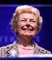"Phyllis Schlafly, a conservative activist, organized opposition to the ERA and argued that it ""would lead to women being drafted by the military and to public unisex bathrooms""[91]"