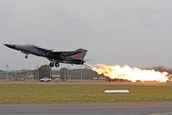 A Royal Australian Air Force F-111C performing a dump-and-burn, a procedure where the fuel is intentionally ignited using the aircraft's afterburner