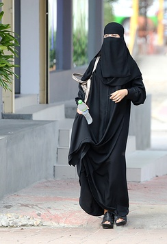 Saudi woman wearing a niqāb in Riyadh. Under Saudi law, women are required to wear a abaya but niqab and hijab is optional.