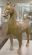 An Eastern Han glazed ceramic statue of a horse with bridle and halter headgear, from Sichuan, late 2nd century to early 3rd century AD