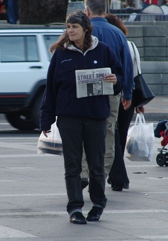 A street newspaper vendor, selling Street Sheet, in San Francisco, United States