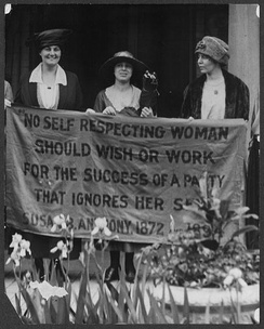 Photograph of (L-R) Kenyon Rector, Mary Dubrow, and Alice Paul standing outside the 1920 Republican National Convention in Chicago holding a banner