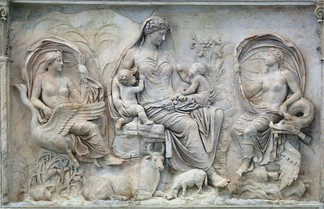 The attributes of the central figure on this panel of the Ara Pacis mark her as an earth and mother goddess, often identified as Tellus.