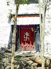 Swastika symbol on the entrance of a Tibetan Buddhism temple.