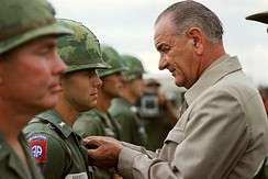 President Johnson in Vietnam 1966, awarding a medal to a U.S. soldier.