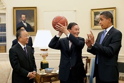 Chinese Vice Premier Wang Qishan, center, holds the autographed basketball given to him by President Obama following their Washington  meeting 28 July 2009, to discuss the outcomes of the first US–China Strategic and Economic Dialogue. Looking on at left is Chinese State Councilor Dai Bingguo.[100]