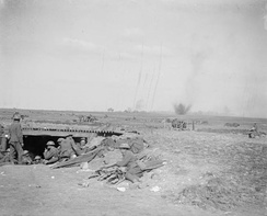 British 18-pounder battery under German fire close to Monchy-le-Preux, 24 April. In the foreground is an advanced dressing station