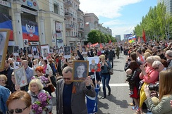 People in Donetsk at «Immortal regiment», carrying portraits of their ancestors who fought in World War II.