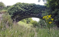 An abandoned stone bridge spans the route of the Otley and Ilkley Joint Railway through Otley, which was closed in 1965.