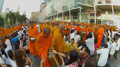 Alms giving to several thousand monks in Bangkok, in an organized event