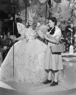Dorothy Gale (Judy Garland, right) with Glinda, the Good Witch of the North (Billie Burke) in 1939 film The Wizard of Oz