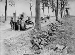 Canadian troops shelter in a ditch along the Arras-Cambrai road