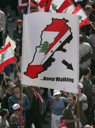 Demonstrators calling for the withdrawal of Syrian forces.