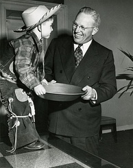 "Governor Warren meets a young ""gold miner"" as part of the California centennials, 1948–50"